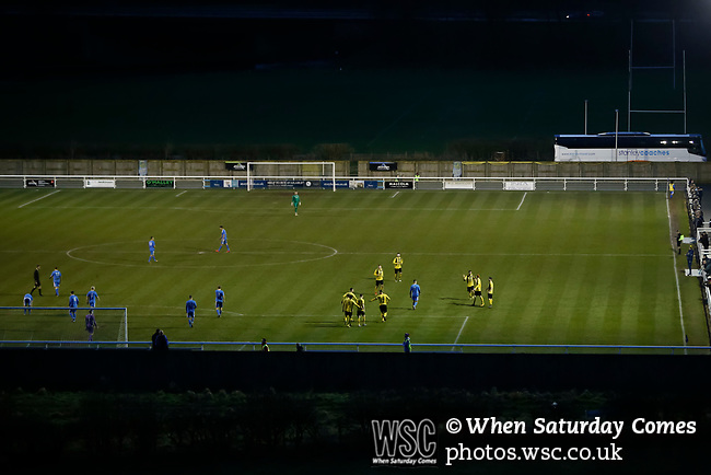 A view of Frenchfield Park from the adjoining fields at twilight. On the pitch Hebburn players celebrate Louis Storey's goal, 1-3. Penrith AFC V Hebburn Town, Northern League Division One, 22nd December 2018. Penrith are the only Cumbrian team in the Northern League. All the other teams are based across the Pennines in the north east.<br /> Penrith, winless at kick off, lost a thriller 3-4, in front of 100 people. They won five games all season, but were reprieved from relegation following Blyth's resignation from the league.