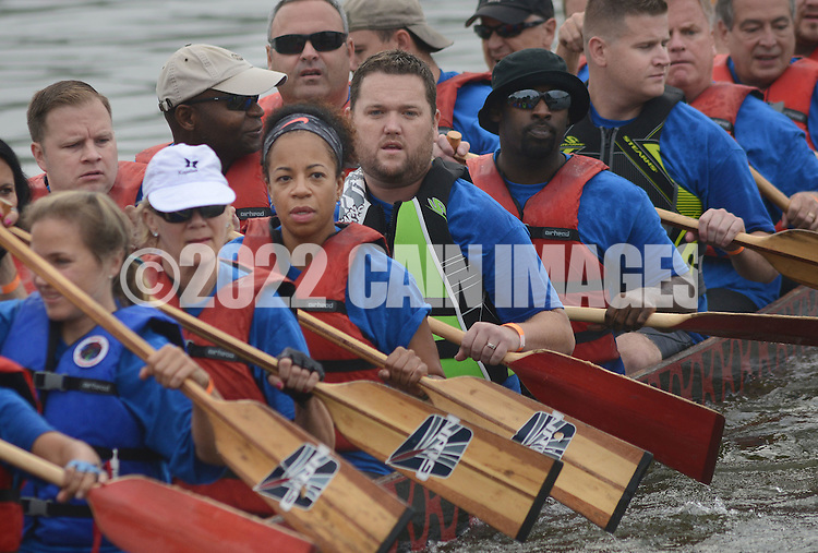 PDRAGON20P<br /> Members of the CTF Dragons paddle on the lake to their heat during the first annual Bucks County Dragon Boat Festival on Lake Luxembourg at Core Creek Park Saturday September 19, 2015 in Langhorne, Pennsylvania.  The purpose of the event is to Paddle Out Hunger with proceeds benefitting Bucks County Housing Group. (William Thomas Cain/For The Inquirer)