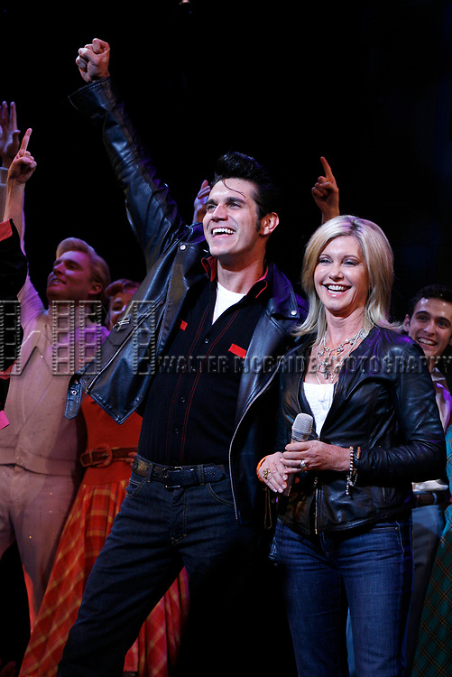 Olivia Newton John and Derek Keeling during Olivia Newton-John is headed back to Rydell High to promote Breast Cancer Awareness after the Curtain Call for GREASE at the Brooks Atkinsoon Yheatre in New York City. <br />October 7, 2008