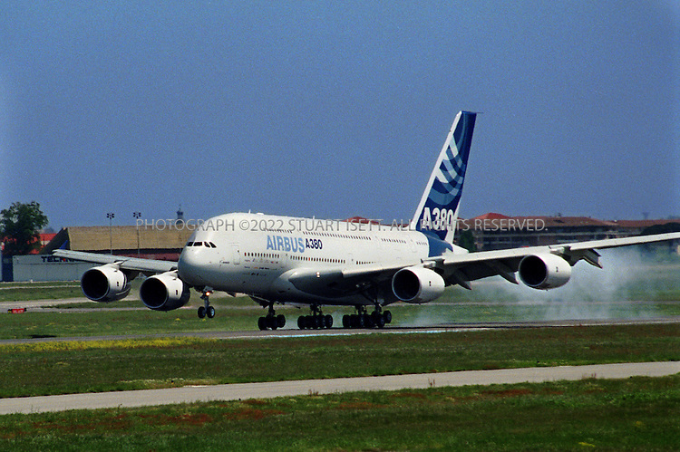 4/27/2005--Toulouse, France..The world's largest passenger plane, the Airbus A380, completed a maiden flight Wednesday (here it is landing) that took it over the Pyrenees mountains, a milestone for aviation and for the European aircraft-maker's battle with American rival Boeing Co...The A380?s first flight is being jointly captained by Claude Lelaie, Senior Vice President of Airbus? Flight Division and Chief Test Pilot and Vice President Jacques Rosay. The other crew members are Fernando Alonso, Vice President Flight Division, Flight Test Engineering, who leads a team of two other flight test engineers Jacky Joye and Manfred Birnfeld, and test flight engineer Gérard Desbois.  ..For its first flight, Airbus? 21st century flagship, carrying the registration F-WW0W, took off at a weight of 421 tonnes / 928,300 lbs, the highest ever of any civil airliner at take-off to date. It is powered by four Rolls-Royce Trent 900 engines. In addition to water ballasts, the equipment on board the A380 comprises a full set of flight-test instrumentation to record the thousands of parameters necessary to enable in-flight performance analysis. ..Photograph By Stuart Isett.All photographs ©2005 Stuart Isett.All rights reserved.