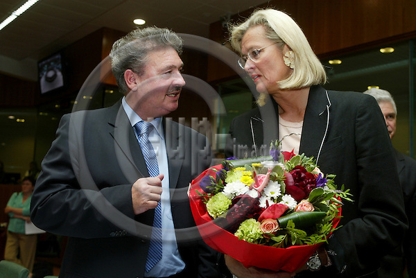 BRUSSELS - BELGIUM - 23 MAY 2005 --GENERAL AFFAIRS AND EXTERNAL RELATIONS--Jean ASSELBORN, Luxembourg Minister for Foreign Affairs, and his Austrian Counterpart Ursula PLASSNIK, with flowers because of her birthday.-- PHOTO: ERIK LUNTANG / EUP-IMAGES..