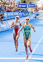12 JUL 2014 - HAMBURG, GER - Emma Jackson (AUS) (right) from Australia outsprints Kirsten Sweetland (CAN) (left) from Canada to the finish line to take second place at the elite women's 2014 ITU World Triathlon Series round in the Altstadt Quarter in Hamburg, Germany (PHOTO COPYRIGHT © 2014 NIGEL FARROW, ALL RIGHTS RESERVED)