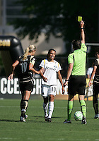 Marta (10) receives a yellow card from Referee Daniel Radford. Los Angeles Sol defeated FC Gold Pride 2-0 at Buck Shaw Stadium in Santa Clara, California on May 24, 2009.