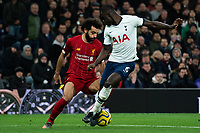 Liverpool's Mohamed Salah holds off the challenge from Tottenham's Davinson Sanchez <br /> <br /> Photographer Stephanie Meek/CameraSport<br /> <br /> The Premier League - Tottenham Hotspur v Liverpool - Saturday 11th January 2020 - Tottenham Hotspur Stadium - London<br /> <br /> World Copyright © 2020 CameraSport. All rights reserved. 43 Linden Ave. Countesthorpe. Leicester. England. LE8 5PG - Tel: +44 (0) 116 277 4147 - admin@camerasport.com - www.camerasport.com