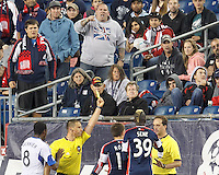Yellow Card: New England Revolution midfielder Kelyn Rowe (11) from Sorin Stoica. In a Major League Soccer (MLS) match, Montreal Impact (white/blue) defeated the New England Revolution (dark blue), 4-2, at Gillette Stadium on September 8, 2013.