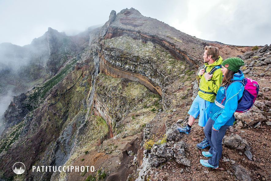 Hikers stopped and putting on more clothes in the changing weather on Madeira Island