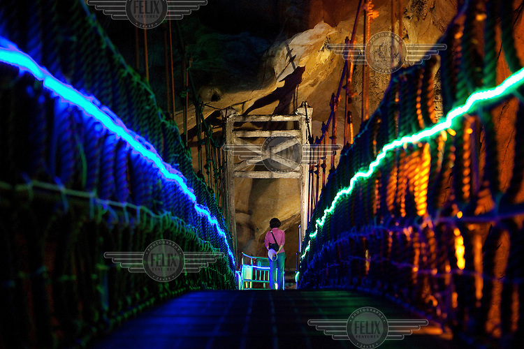 A woman visits the Hwanseon Donggul limestone cave in Samcheok, walking along the 2km long stairway which is lined with colourful fluorescent lighting...