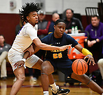 Collinsville guard RaySean Taylor (left) steals the ball from OFallon guard Mason Blakemore. Collinsville played OFallon in a Class 4A Pekin boys basketball sectional semifinal game at Belleville West High School in Belleville, Illinois on Tuesday March 10, 2020. <br /> Tim Vizer/Special to STLhighschoolsports.com