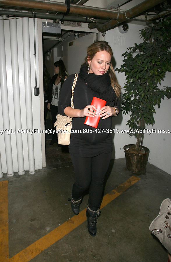 Feb 15th 2012 ..Hilary Duff making a really funny face with sister Haley Heavily pregnant dine at Madeos restaurant n West Hollywood, CA...AbilityFilms@yahoo.com.805-427-3519.www.AbilityFilms.com.