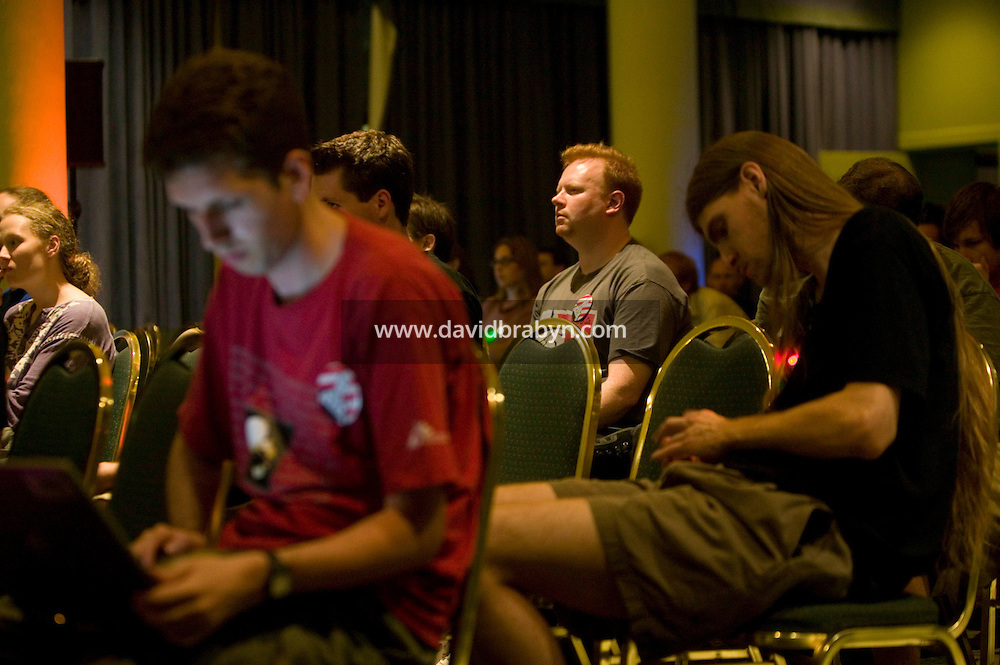 Attendees of the 6th edition of HOPE, an annual hackers' convention, listen to a talk, July 22nd 2006, New York City, USA.