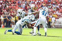 Landover, MD - September 16, 2018: Washington Redskins tight end Vernon Davis (85) is tackled by several Indianapolis Colts players during the  game between Indianapolis Colts and Washington Redskins at FedEx Field in Landover, MD.   (Photo by Elliott Brown/Media Images International)