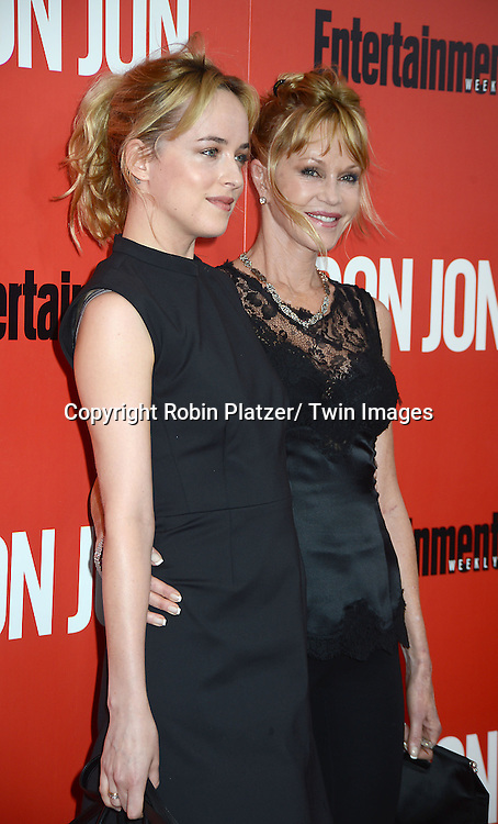 "Dakota Johnson and her mother Melanie Griffith attends the ""Don Jon"" New York Movie Premiere on September 12, 2013 at the SVA Theatre in New York City."