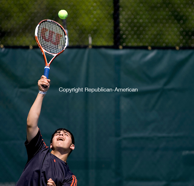 LAKEVILLE, CT - 21 MAY 2010 -052110JT08-<br /> Thomaston's Pat Capobianco serves the ball to Northwestern's Matt Dunlop during Friday's Berkshire League Tennis Championship at the Hotchkiss School in Lakeville.<br /> Josalee Thrift Republican-American