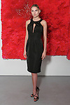 Zorana poses in a black peau de soie deep v-neck dress with bow from the Barbara TFank Spring Summer 2016 collection, at a fashion show presentation in the Leila Heller Gallery during New York Fashion Week Spring Summer 2017, on September 12, 2016.
