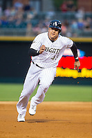 Avisail Garcia (43) of the Charlotte Knights hustles towards third base against the Gwinnett Braves at BB&T Ballpark on August 6, 2014 in Charlotte, North Carolina.  The Knights defeated the Braves  12-10.  (Brian Westerholt/Four Seam Images)