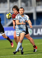 Hendon, England. Gareth Davies of Cardiff Blues clears the ball during the LV= Cup match for the first professional rugby game on the artificial turf pitch made for rugby between Saracens and Cardiff Blues at Allianz Park Stadium on January 27, 2013 in Hendon, England.