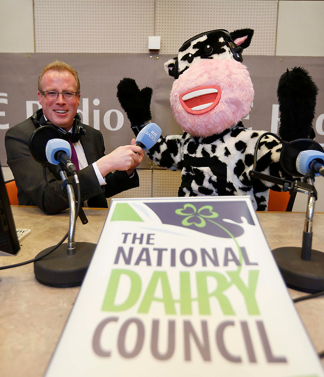 "No Repro Fee..Damien O'Reilly, Presenter of RTE Radio 1's Country Wide, pictured with the National Dairy Council's Mascot ""Millie the Cow"" in the RTE  radio studio's at the Announcement that the National Dairy Council (NDC) as the new sponsor of the station's farming, food and rural affairs programme, Countrywide. Pic. Robbie Reynolds"