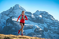 Trail running from the Lauterbrunnen Valley to the Schilthorn, Switzerland, with the Gspaltenhorn in the background.