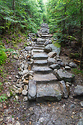 Long stone staircase along the Mt Tecumseh Trail in Waterville Valley, New Hampshire in June 2015. Conservation groups suggest that stonework built along trails should be minimal, look natural, and blend in with the surroundings.