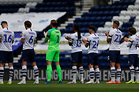 11th July 2020; Deepdale Stadium, Preston, Lancashire, England; English Championship Football, Preston North End versus Nottingham Forest; A minutes applause from Preston North End players and match officials to mark the passing of World Cup winner Jack Charlton