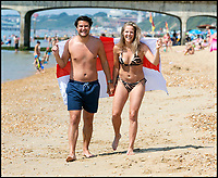 BNPS.co.uk (01202 558833)<br /> Pic: LeeMcLean/BNPS<br /> <br /> Couple James Lee-Legon (29) and Lisa Holmback (26- originally from Sweden), are flying the flag for England after yesterdays win. <br /> <br /> Sizzling Sunday in Bournemouth as football fever gripped the seaside resort after England win to take them into the Semi-Finals of the World Cup.