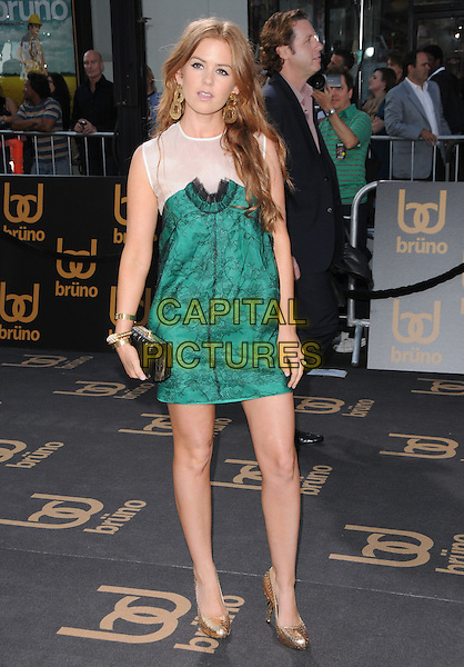 """ISLA FISHER .The Universal Pictures' L.A. Premiere of """"Bruno"""" held at the Grauman's Chinese Theatre in Hollywood, California, USA. .June 25th, 2009.full length white sheer green pattern dress sleeveless black clutch bag gold lace shoes .CAP/DVS.©Debbie VanStory/Capital Pictures."""