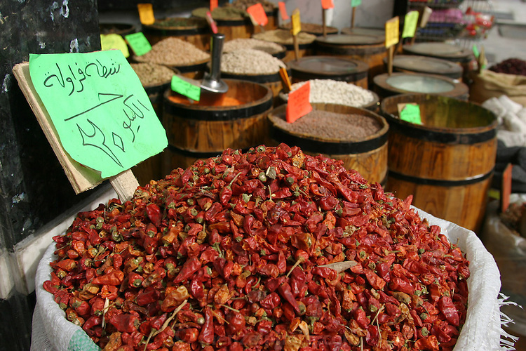 Dried chili peppers and barrels of spices on the sidewalk in front of a spice shop in Cairo, Egypt. (Supporting image from the project Hungry Planet: What the World Eats.)