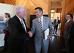 Nevada Gov. Brian Sandoval and Assembly Speaker John Hambrick talk at a bill signing ceremony at the historic Fourth Ward School in Virginia City, Nev., on Monday, April 13, 2015.<br /> Photo by Cathleen Allison