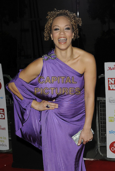 ANGELA GRIFFIN .At the Children's Champions Awards 2010, Grosvenor House Hotel, Park Lane, London, England, UK, .March 3rd 2010..arrivals half length purple dress one shoulder sleeve hand on hip clutch bag long maxi silver grecian hand on hip mouth open funny .CAP/CAN.©Can Nguyen/Capital Pictures.
