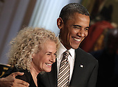 United States President Barack Obama awards  singer-songwriter Carole King the 2013 Library of Congress Gershwin Prize for Popular Song during a concert at the White House in Washington, DC on May 22, 2013..Credit: Yuri Gripas / Pool via CNP