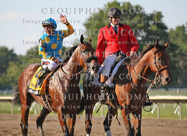 Jockey Victor Espinoza waves to the crowd aboard American Pharoah after winning the $1,750,000 Grade 1 William Hill Haskell Invitational at Monmouth Park in Oceanport, New Jersey on Sunday August 2, 2015.  Photo By Ryan Denver/EQUI-PHOTO.