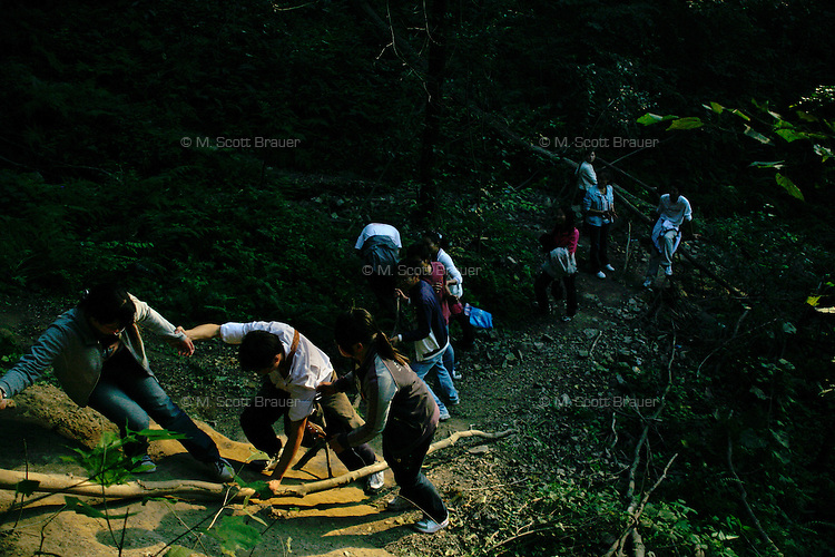 People climb up the hillside on a shortcut up the Purple-Gold Mountain in Nanjing, China.  The Purple-Gold Mountain, known also as Purple Mountain or, in Chinese, Zijin Shan, is a tourist site popular with locals as a weekend destination.  It's also the location of the Sun-Yat Sen Mausoleum.