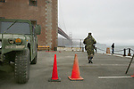 "The National Guard posted under the Golden Gate Bridge at Fort Point, in preparation for the 4th ofJuly. The National Guard patrols call ""Team Golden Gate"" are now symbols of full time soldiers packing rifles and working 12 hours shifts."