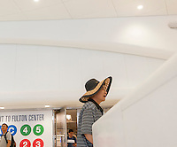 An elderly Asian tourist in the World Trade Center Transportation Hub, known as the Oculus, on Tuesday, August 16, 2016 during the grand opening of the retail spaces. The 350,000 square foot retail space will feature over 100 stores when they all open, including a now opened Apple Store. The mall opens almost 15 years after the World Trade Center terrorist attack.  (© Richard B. Levine)