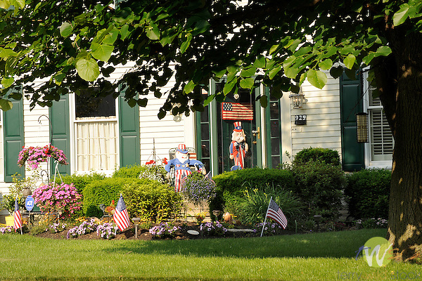 Country Club lane home with Memorial Day decorations and flowers..
