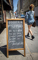 A restaurant in the Chelsea neighborhood of New York advertises an alternative to paying off your impossible to pay student debt by drinking sangria, seen on Thursday, June 20, 2013.   (© Richard B. Levine)