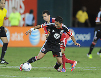 D.C. United midfielder Marcelo Saragosa (11) shields the ball from Chicago FIre defender midfielder Marco Pappa (16) D.C. United defeated The Chicago Fire 4-2 at RFK Stadium, Wednesday August 22, 2012.