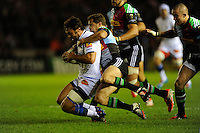 Thomas Combezou of Castres Olympique is tackled by Nick Evans of Harlequins during the European Rugby Champions Cup  Round 1 match between Harlequins and Castres Olympique at the Twickenham Stoop on Friday 17th October 2014 (Photo by Rob Munro)