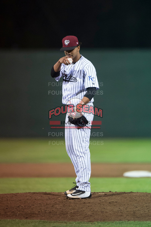 Idaho Falls Chukars relief pitcher Domingo Pena (15) during a Pioneer League game against the Great Falls Voyagers at Melaleuca Field on August 18, 2018 in Idaho Falls, Idaho. The Idaho Falls Chukars defeated the Great Falls Voyagers by a score of 6-5. (Zachary Lucy/Four Seam Images)