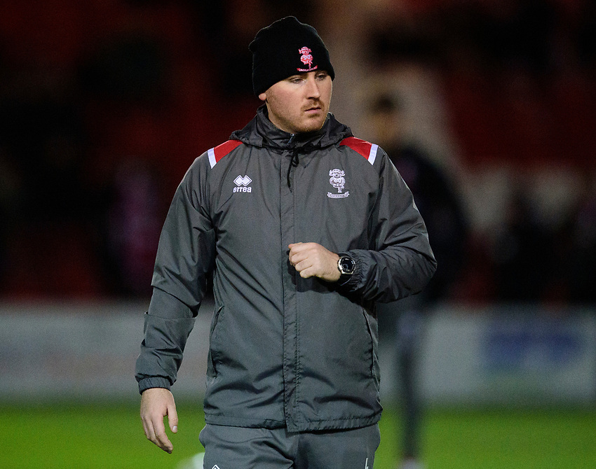 Lincoln City's head of sports science Luke Jelly during the pre-match warm-up<br /> <br /> Photographer Andrew Vaughan/CameraSport<br /> <br /> The EFL Sky Bet League One - Lincoln City v Milton Keynes Dons - Tuesday 11th February 2020 - LNER Stadium - Lincoln<br /> <br /> World Copyright © 2020 CameraSport. All rights reserved. 43 Linden Ave. Countesthorpe. Leicester. England. LE8 5PG - Tel: +44 (0) 116 277 4147 - admin@camerasport.com - www.camerasport.com