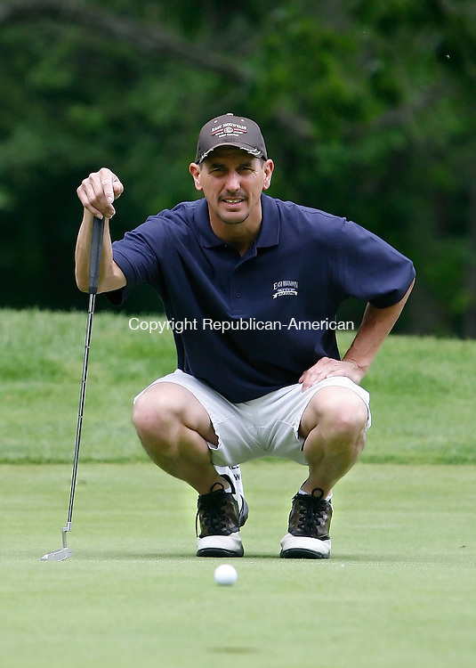 Waterbury, CT-22 June 2008-062208MK12 Doug Pemberton eyes the course of his putt on the first green at the Republican-American City Championship at East Mountain golf course Sunday morning. Michael Kabelka Republican-American ( Doug Pemberton )CQ