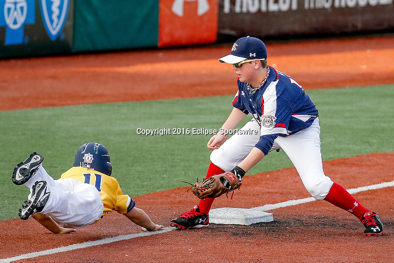 ABERDEEN, MD - AUGUST 02: Cole Dickinson #12 of New Milford (CT) tags out Finn O'Connor #11 of Southeast Denver (CO) at third base in a game between New England and Midwest Plains during the Cal Ripken World Series at The Ripken Experience Powered by Under Armour on August 2, 2016 in Aberdeen, Maryland. (Photo by Ripken Baseball/Eclipse Sportswire/Getty Images)