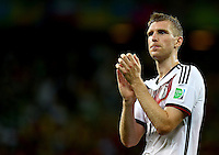 Per Mertesacker of Germany applauds the fans at full time after winning his 100th cap for his country
