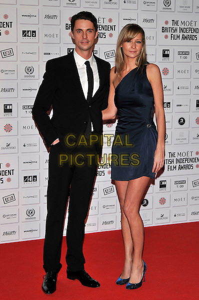 MATTHEW GOODE & SOPHIE DYMOKE .attending the Moet British Independent Film Awards at Old Billingsgate Market, London, England, UK,.December 5th, 2010..full length blue black dress suit tie one shoulder dress navy shoes .CAP/PL.©Phil Loftus/Capital Pictures.