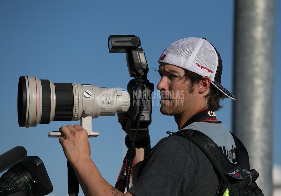 Mar. 1, 2013; Avondale, AZ, USA; Los Angeles Angels pitcher C.J. Wilson works as a member of the media during NASCAR Sprint Cup Series qualifying for the Subway Fresh Fit 500 at Phoenix International Raceway. Mandatory Credit: Mark J. Rebilas-