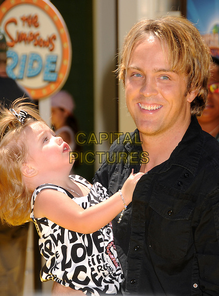 "LARRY BIRKHEAD & daughter DANNIELYNN  .""The Simpsons Ride"" Opening at Universal Studios Hollywood, Universal City, California, USA..May 17th, 2008.daniellynn half length baby Anna Nicole Smith's daughter black shirt white print lifting carrying father dad family .CAP/ADM/BP.©Byron Purvis/AdMedia/Capital Pictures."
