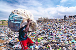 WITH VIDEO<br /> <br /> Men swim through waters strewn with tonnes of rubbish to find and collect plastic to sell.  People risked serious injury by wading through the polluted lagoon which is completely covered by bottles, takeaway boxes and other harmful, single-use plastics.<br /> <br /> The photographs reveal the shocking state of plastic pollution in Ghana's capital, Accra, as rainfall causes plastic dumped in the city's waterways to flow into Korle Lagoon.  SEE OUR COPY FOR DETAILS.<br /> <br /> Please byline: Muntaka Chasant/Solent News<br /> <br /> © Muntaka Chasant/Solent News & Photo Agency<br /> UK +44 (0) 2380 458800