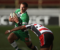 Manawatu first five Aaron Cruden tries to beat Seremaia Tagicakibau during the Air NZ Cup rugby match between Manawatu Turbos and Counties-Manukau Steelers at FMG Stadium, Palmerston North, New Zealand on Sunday, 2 August 2009. Photo: Dave Lintott / lintottphoto.co.nz