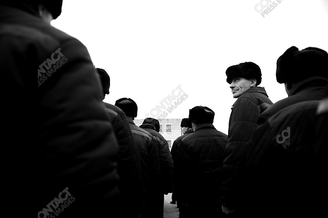 Prisoners formed ranks to march back to their lodgings after lunch. Prison colony #7 outside of Novgorod in the Novgorod region south of St. Petersburg, Russia, December 15, 2008.