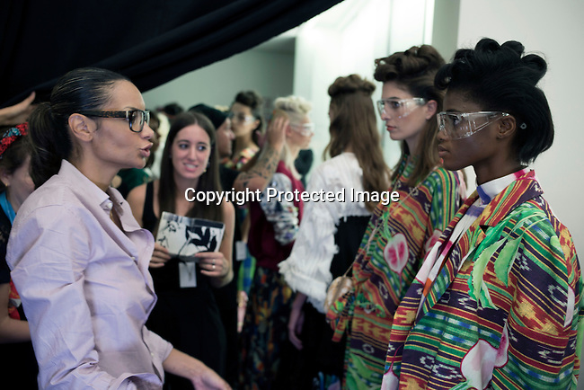 MILAN, ITALY - SEPTEMBER 23: Italian Haitian designer Stella Jean prepare her models backstage before her show at Milan Fashion Week Spring/Summer Milan 2016, in Milan, Italy. (Photo by: Per-Anders Pettersson)